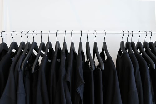 image of black clothes hanging on rack